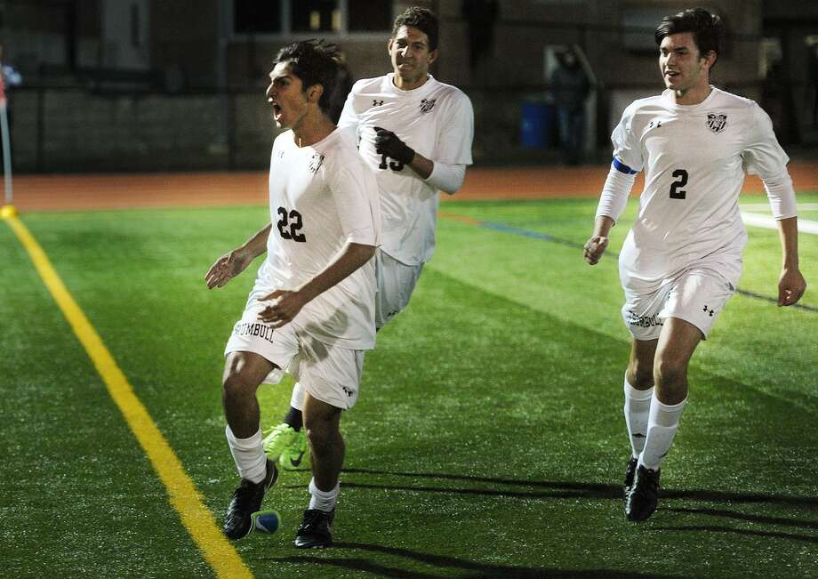 Trumbull's Andrew Restrepo celebrates his overtime goal with teammates Matheus Santiago and Nicholaos Xanakis to give the Eagles a 1-0 victory over Danbury in an FCIAC boys soccer semifinal at Ludlowe High School in Fairfield on Monday. Photo: Brian A. Pounds / Hearst Connecticut Media / Connecticut Post