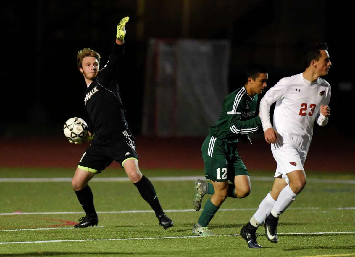 Norwalk goalkeeper Cole Judkins throws the ball after making a save in the FCIAC high school boys soccer semifinal game between Greenwich and Norwalk at Fairfield Ludlowe High School in Fairfield, Conn. Monday, Oct. 30, 2017.