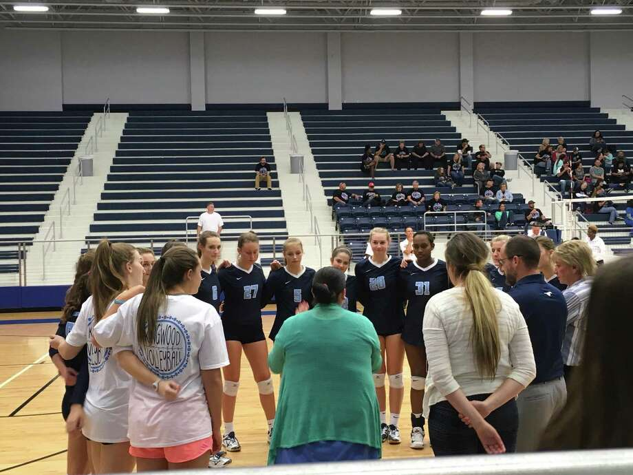 Coach Ashley Earhart addresses the Kingwood volleyball team before their bi-district playoff match against Pasadena Memorial on Monday evening at the Bill Neal Center in Channelview Photo: Elliott Lapin
