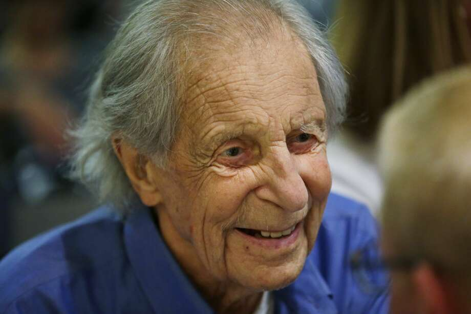 """In this photo taken July 26, 2016 in Seattle, Fred Beckey, 93, the legendary mountain climber who has bagged more first ascents than any other mountaineer and wrote the definitive guidebooks to a major North American mountain range, visits with guests during a promotional event for """"Dirtbag: The Legend of Fred Beckey,"""" an upcoming documentary feature film about his life in Seattle. (AP Photo/Ted S. Warren) Photo: Ted S. Warren/AP"""