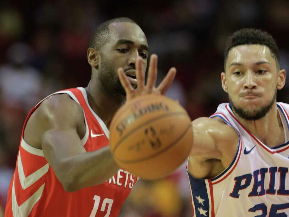 Rockets forward Luc Mbah a Moute, left, and the 76ers' Ben Simmons chase down an errant pass Monday. Photo: Elizabeth Conley, Houston Chronicle / © 2017 Houston Chronicle
