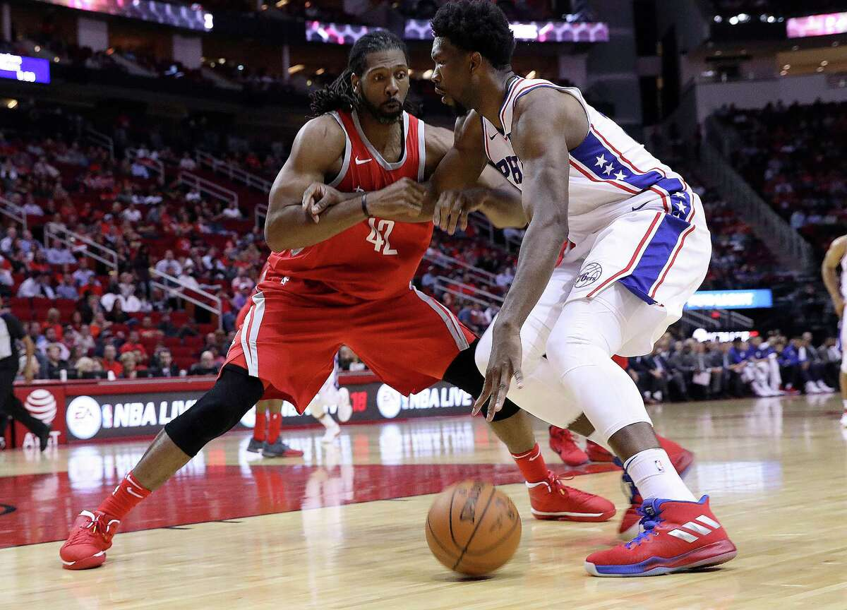 Houston Rockets center Nene Hilario (42) applies defensive pressure against Philadelphia 76ers center Joel Embiid (21) at the Toyota Center on Monday, Oct. 30, 2017, in Houston.