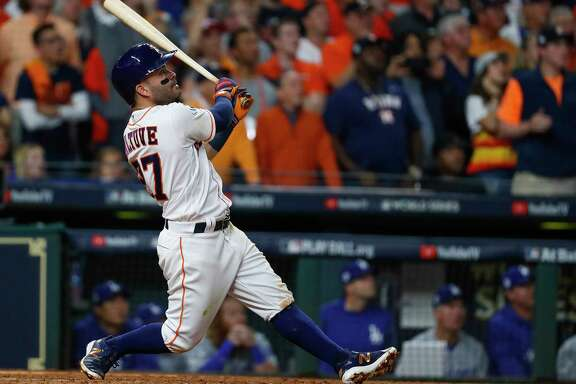 Astros second baseman Jose Altuve connects on a three-run homer, his seventh long ball this postseason, in the fifth inning to tie at 7-7 Sunday's Game 5 of the World Series with the Dodgers.