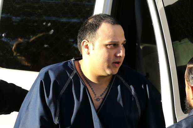 Jesse Santibanez leaves a van at the John Wood Federal Courthouse Monday October 30, 2017. He is charged with killing Balcones Heights police officer Julian Pesina in 2014.