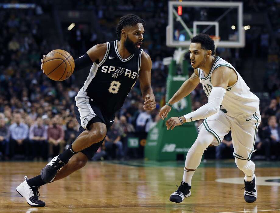 San Antonio Spurs' Patty Mills (8) drives past Boston Celtics' Shane Larkin during the second quarter of an NBA basketball game in Boston, Monday, Oct. 30, 2017. (AP Photo/Michael Dwyer)