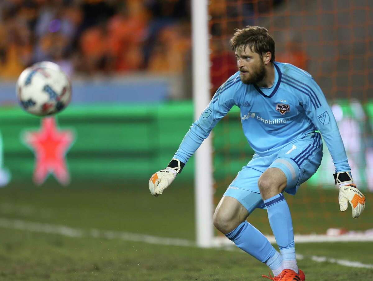 Houston Dynamo goalkeeper Tyler Deric (1) goes back to his position after a save during the first half of Leg 1 MLS Semifinal match at BBVA Compass Stadium Monday, Oct. 30, 2017, in Houston.