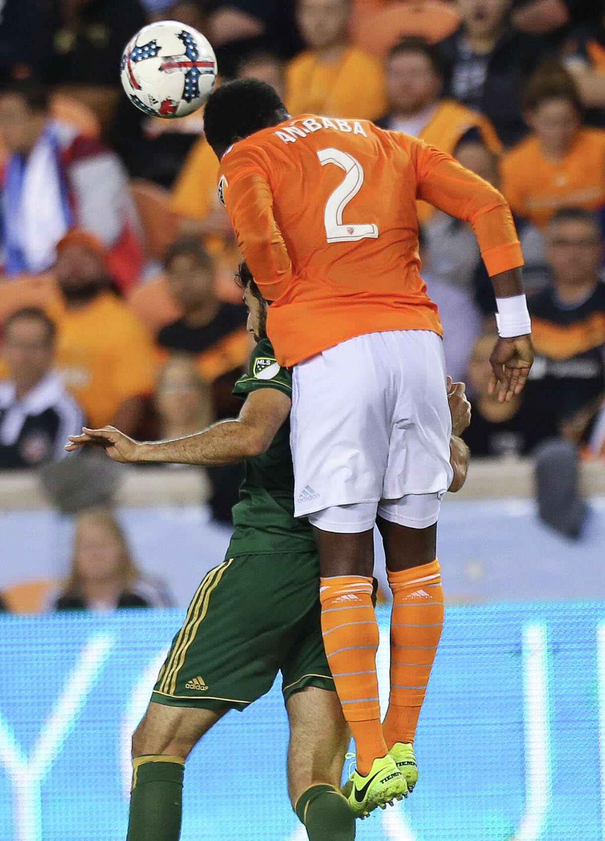 Houston Dynamo defender Jalil Anibaba (2) wins the header over Portland Timbers midfielder Diego Valeri (8) during the first half of Leg 1 MLS Semifinal match at BBVA Compass Stadium Monday, Oct. 30, 2017, in Houston.