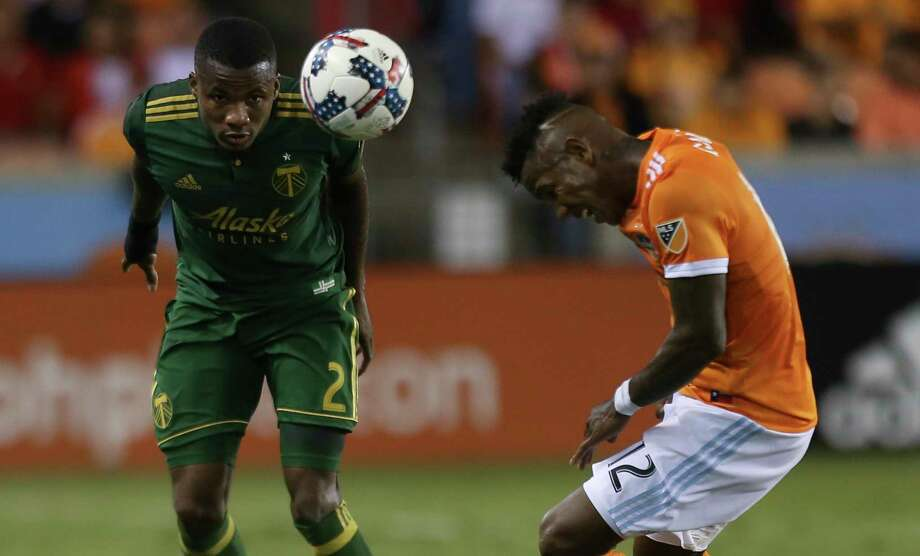 Houston Dynamo forward Romell Quioto (12) and Portland Timbers defender Alvas Powell (2) try to use their head to get the ball during the first half of Leg 1 MLS Semifinal match at BBVA Compass Stadium Monday, Oct. 30, 2017, in Houston. Photo: Yi-Chin Lee, Houston Chronicle / © 2017  Houston Chronicle