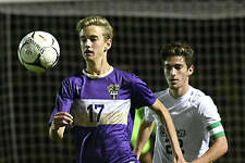 Christian Brothers Academy's Brady Van Epps is trailed by Shenendehowa's Noah Faro during the Section II Class AA boys soccer final on Monday, Oct 30, 2017 in Colonie, N.Y. (Lori Van Buren / Times Union)