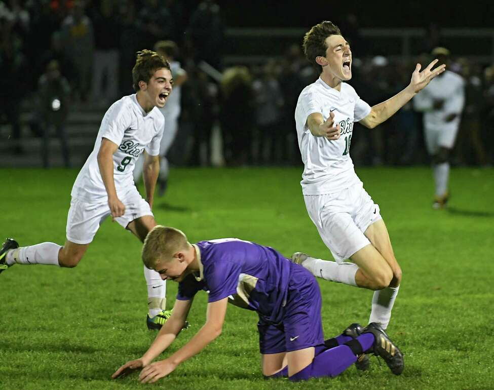 Shenendehowa's Nick Evans, left, and Ethan Behan celebrate after defeating Christian Brothers Academy in the Section II Class AA boys soccer final on Monday, Oct 30, 2017 in Colonie, N.Y. (Lori Van Buren / Times Union)