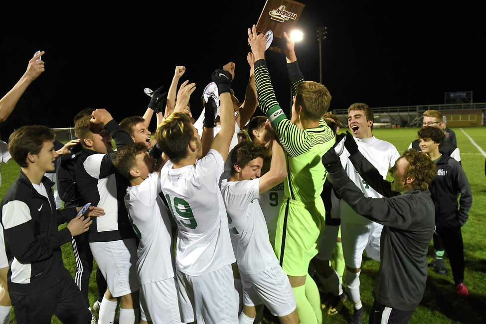 Shenendehowa celebrates after defeating Christian Brothers Academy in the Section II Class AA boys soccer final on Monday, Oct 30, 2017 in Colonie, N.Y. (Lori Van Buren / Times Union)