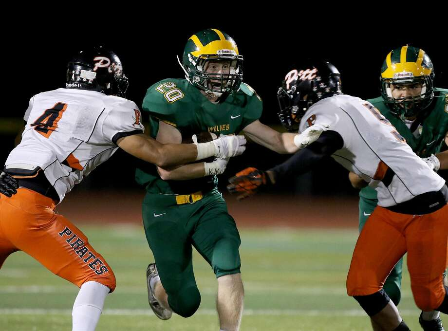 Quarterback Clark Baker (2) and running back Daniel Medley (20) may be key to helping San Ramon Valley-Danville do something this week no Northern California team has done since 1991: beat De La Salle-Concord. Photo: Dennis Lee, MaxPreps