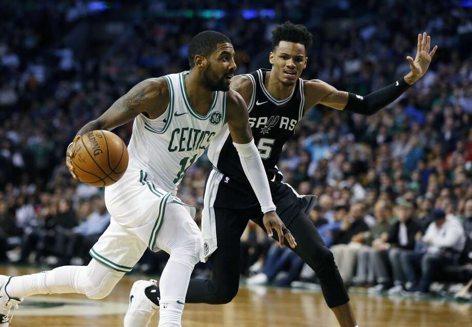 Boston Celtics' Kyrie Irving (11) drives past San Antonio Spurs' Dejounte Murray (5) during the third quarter of an NBA basketball game in Boston, Monday, Oct. 30, 2017. TheCelticswon 108-94. (AP Photo/Michael Dwyer)