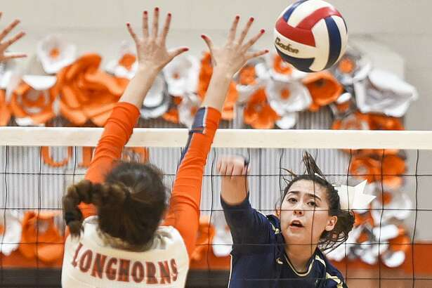 Alexander High School Amber Tran attacks as United High School Carolina Medellin reaches for the block on Oct. 24, 2017, during a game at United High School.