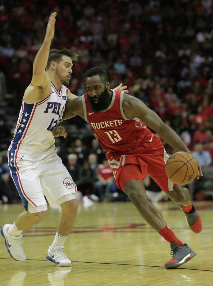Houston Rockets guard James Harden (13) drives around Philadelphia 76ers guard T.J. McConnell (12) at the Toyota Center on  Monday, Oct. 30, 2017, in Houston. Rockets lost the game 115-107. Photo: Elizabeth Conley, Houston Chronicle / © 2017 Houston Chronicle