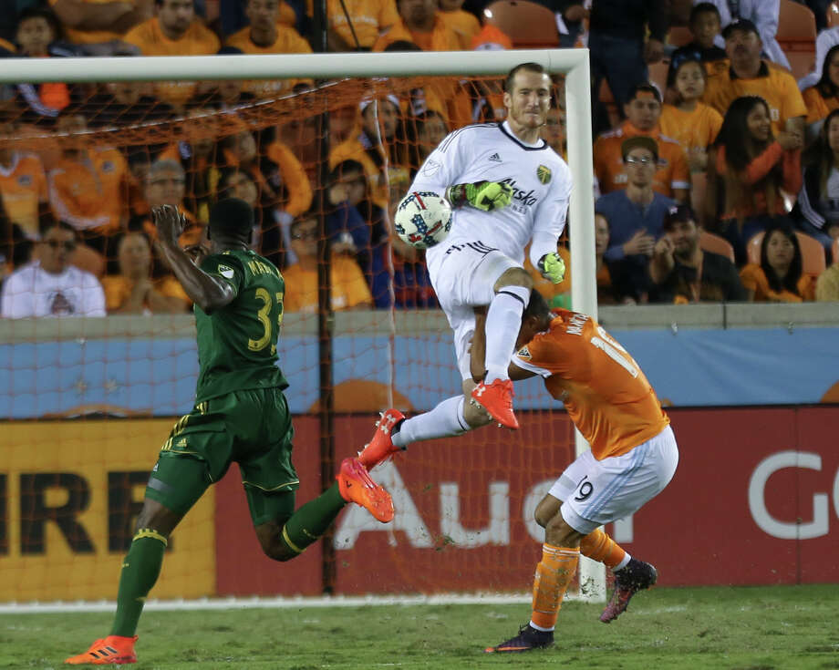 Portland Timbers goalkeeper Jeff Attinella (1) collides with Houston Dynamo forward Mauro Manotas (19) as he comes out to get the ball away from Manotas during the MLS Western Conference semifinal soccer match Monday, Oct. 30, 2017, in Houston. (Yi-Chin Lee/Houston Chronicle via AP) Photo: Yi-Chin Lee, MBO / ' 2017 Houston Chronicle