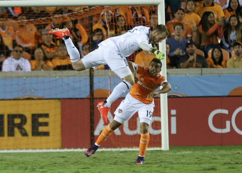 Timbers goalkeeper Jeff Attinella, top, nearly collides with Dynamo forward Mauro Manotas as he comes out to clear the ball away from Manotas and preserve the shutout. Photo: Yi-Chin Lee, Houston Chronicle / © 2017  Houston Chronicle