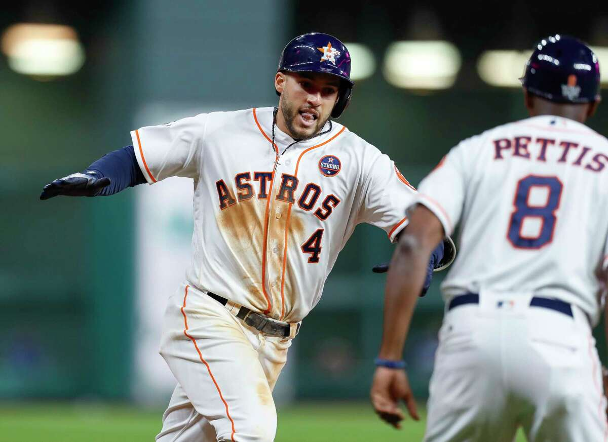 Houston Astros center fielder George Springer (4) rounds third after hitting a solo home run to lead off the seventh inning of Game 5 of the World Series at Minute Maid Park on Sunday, Oct. 29, 2017, in Houston. ( Brett Coomer / Houston Chronicle )
