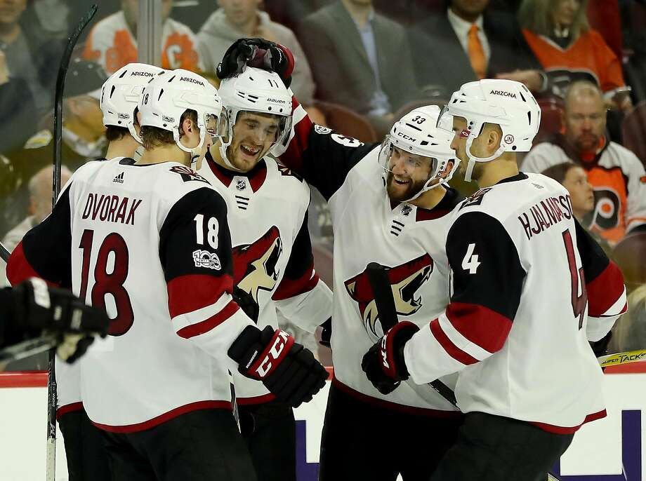 PHILADELPHIA, PA - OCTOBER 30:  Brendan Perlini #11 of the Arizona Coyotes is congratulated by teamamtes Christian Dvorak #18,Alex Goligoski #33 and Niklas Hjalmarsson #4 after Perlini scored a goal in the third period against the Philadelphia Flyers on October 30, 2017 at Wells Fargo Center in Philadelphia, Pennsylvania.  (Photo by Elsa/Getty Images) Photo: Elsa, Getty Images