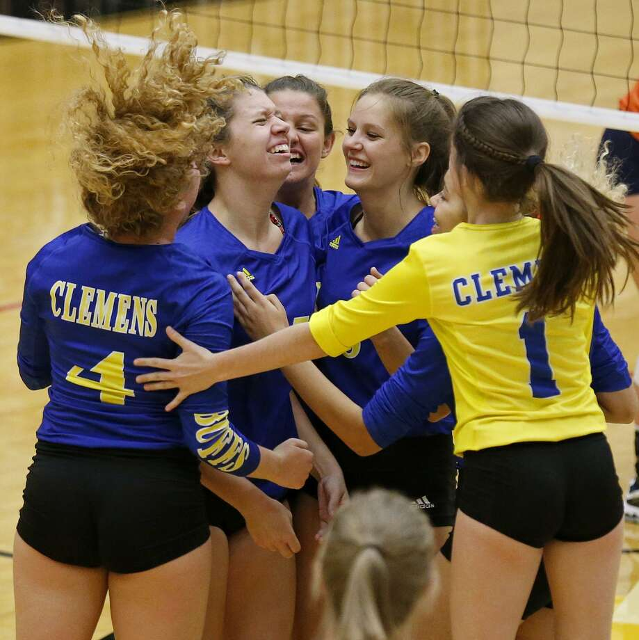 Clemens players celebrate their win over Brandeis during their Class 6A bi-district match held Monday Oct. 30, 2017 at Littleton Gym. Clemens won 17-25, 25-23, 25-16, 25-22. Photo: Edward A. Ornelas, Staff / San Antonio Express-News / © 2017 San Antonio Express-News