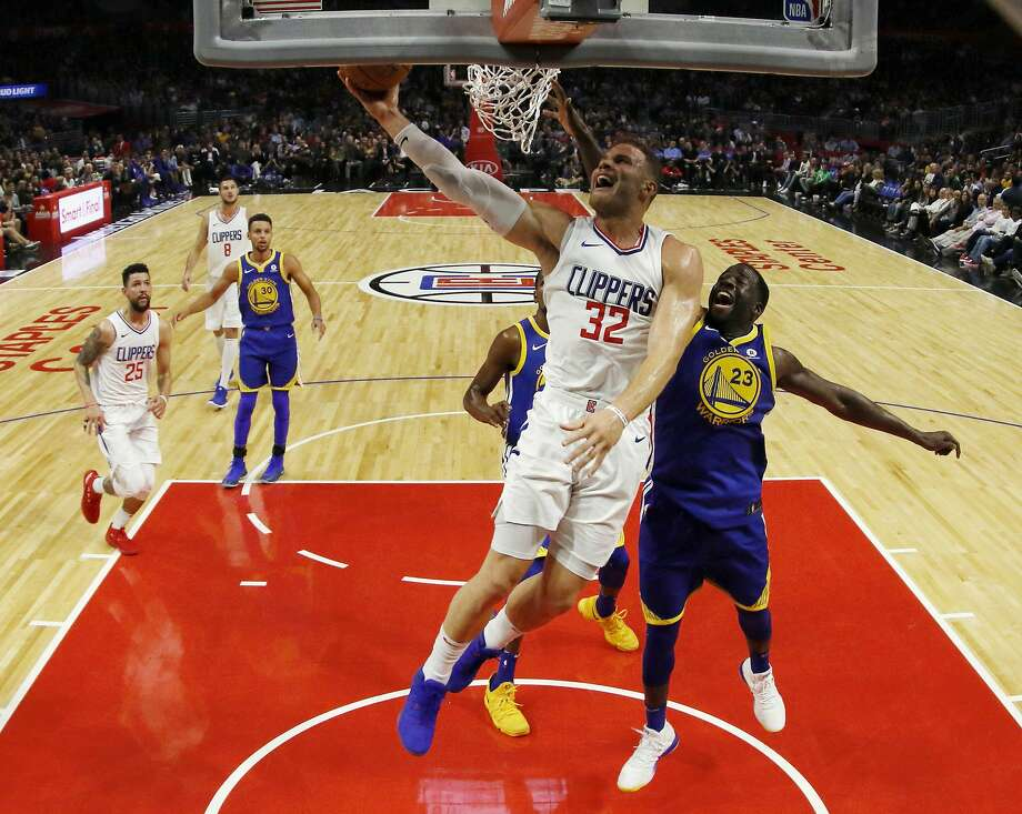 Los Angeles Clippers forward Blake Griffin, center, goes to the basket while being defended by Golden State Warriors forward Draymond Green, right, during the first half of an NBA basketball game, Monday, Oct. 30, 2017, in Los Angeles. (AP Photo/Ryan Kang) Photo: Ryan Kang, Associated Press