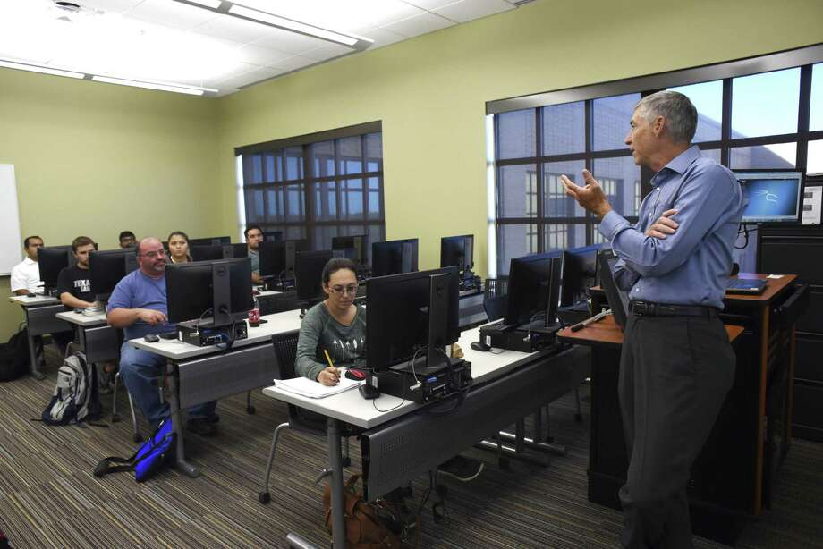 Dr. Kevin Barton teaches a cyber security class at Texas A&M University - San Antonio on Thursday, Oct. 26, 2017. The university has been redesignated by the National Security Agency as a National Center for Academic Excellence in Cyber Defense Education (CAE-CDE) through the year 2022. Photo: Billy Calzada, Staff / San Antonio Express-News / San Antonio Express-News