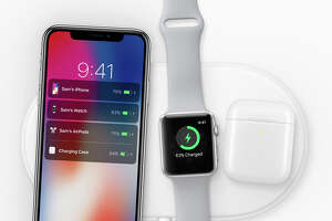 iPhone X, Watch and AirPod case on the AirPower charging mat.