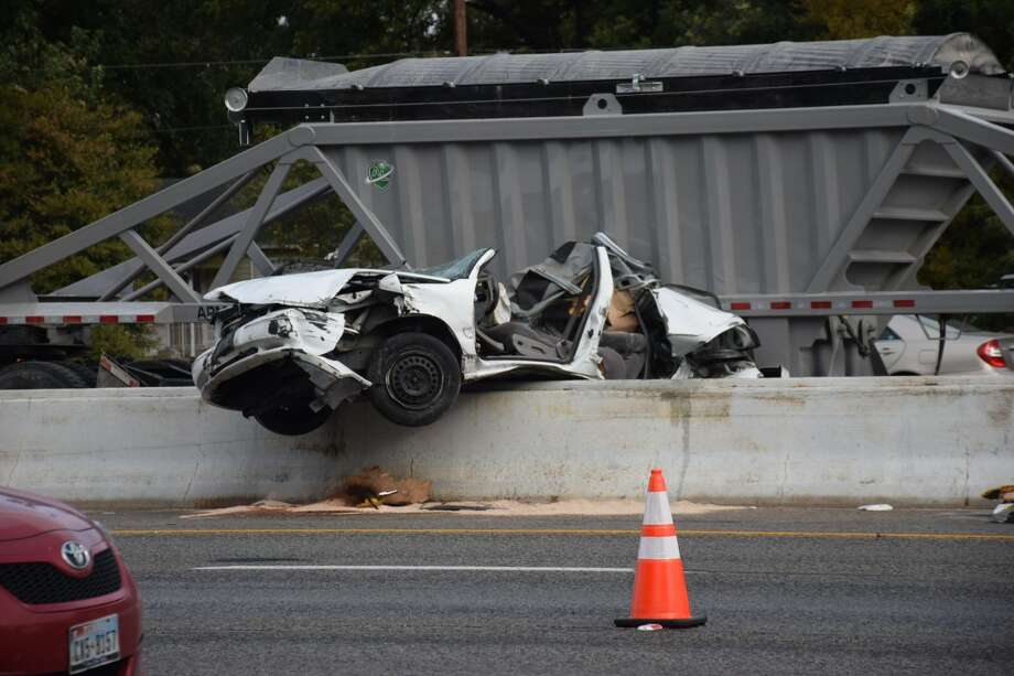 San Antonio police are on the scene of a fatal accident involving an 18-wheeler, which closed multiple lanes of westbound U.S. Highway 90 near Nogalitos on Tuesday, Oct. 31, 2017. Photo: Caleb Downs/San Antonio Express-News