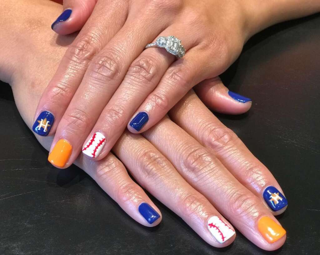 Mzelle Nguyen shows off this orange and blue nail design. Photo: Mz.elle - Houston Astros Fans And Nail Artists Are Painting The Town Orange