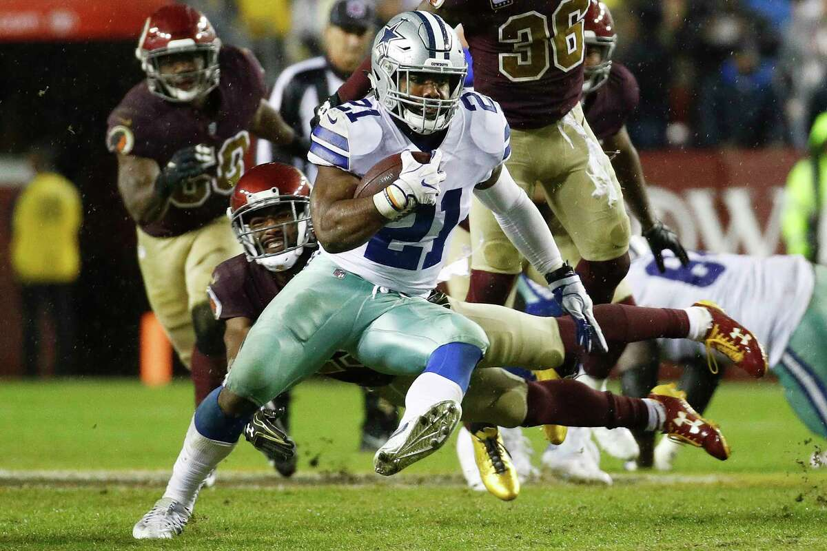 Dallas Cowboys running back Ezekiel Elliott (21) carries the ball during the second half of an NFL football game against the Washington Redskins in Landover, Md., Sunday, Oct. 29, 2017. (AP Photo/Patrick Semansky)