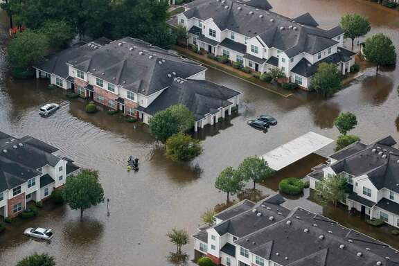 A boat floats in an apartment complex off Rayford Road flooded by Hurricane Harvey. Nearly 11,000 apartments were rented in the Houston region between the end of August and the end of September. That is typically the amount rented in an entire year. Apartment demand has continued in October.