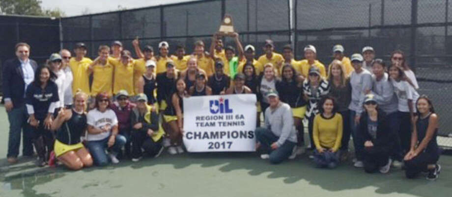 The Cypress Ranch High School tennis team celebrates its Region III-6A championship Oct. 27 after defeating Kingwood. The Mustangs lost in the regional finals a year ago, advancing to the UIL State Team Tennis Tournament for the first time. Photo: Cy-Fair ISD