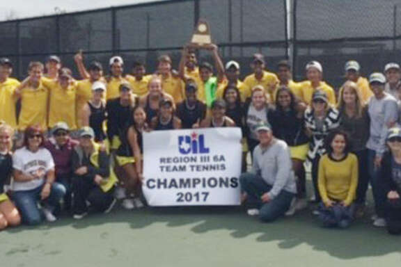 The Cypress Ranch High School tennis team celebrates its Region III-6A championship Oct. 27 after defeating Kingwood. The Mustangs lost in the regional finals a year ago, advancing to the UIL State Team Tennis Tournament for the first time.