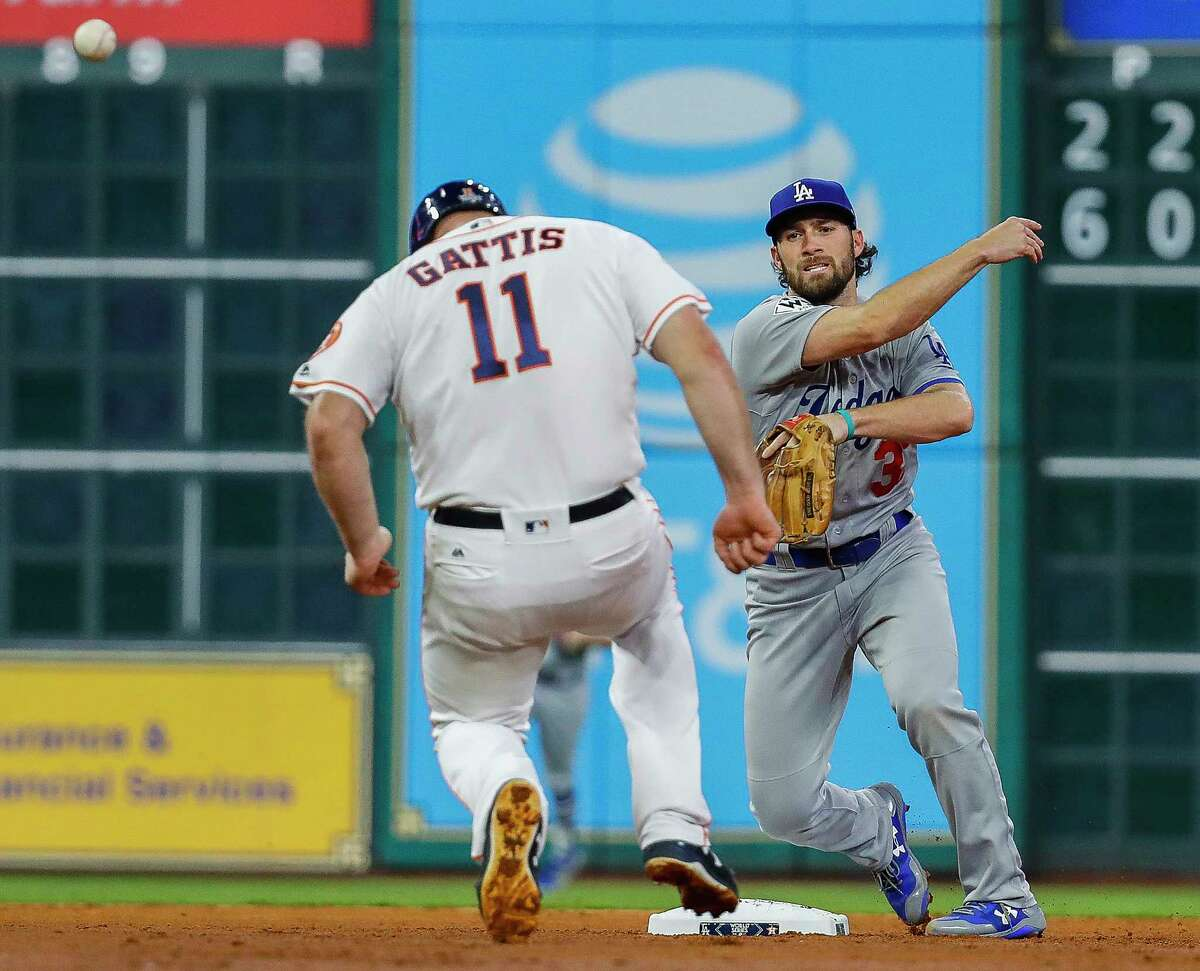 THIRD INNING - DODGERS 3, ASTROS 0 Evan Gattis broke through for the first hit off Kershaw, but a double play ended the rally.