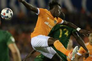Dynamo and forward Alberth Elis, left, play at Portland for the chance to compete against Seattle in the MLS Western Conference finals.