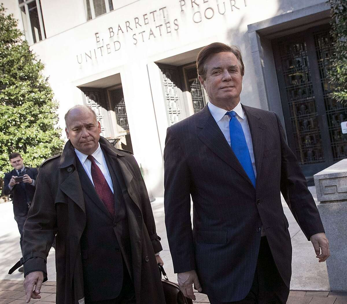 Former campaign manager for U.S. President Donald Trump, Paul Manafort (R), leaves U.S. District Court after pleading not guilty following his indictment on federal charges on October 30, 2017 in Washington, D.C. Manafort was indicted on charges of funneling millions of dollars through overseas shell companies.