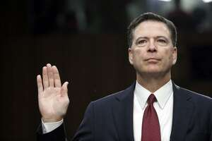 Former FBI Director James Comey is sworn in during a Senate Intelligence Committee hearing on Capitol Hill.