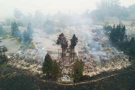 Smoldering fires are seen in the remains of the Hilton Sonoma Wine Country hotel in Santa Rosa, Calif. on Tuesday, October 10, 2017.