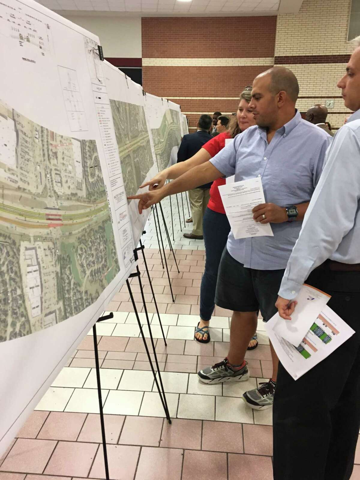 Grand Lakes resident Mitch Abahusayn, center, says noise levels are a problem with current traffic on Texas 99 between Interstate 10 and the Westpark Tollway.