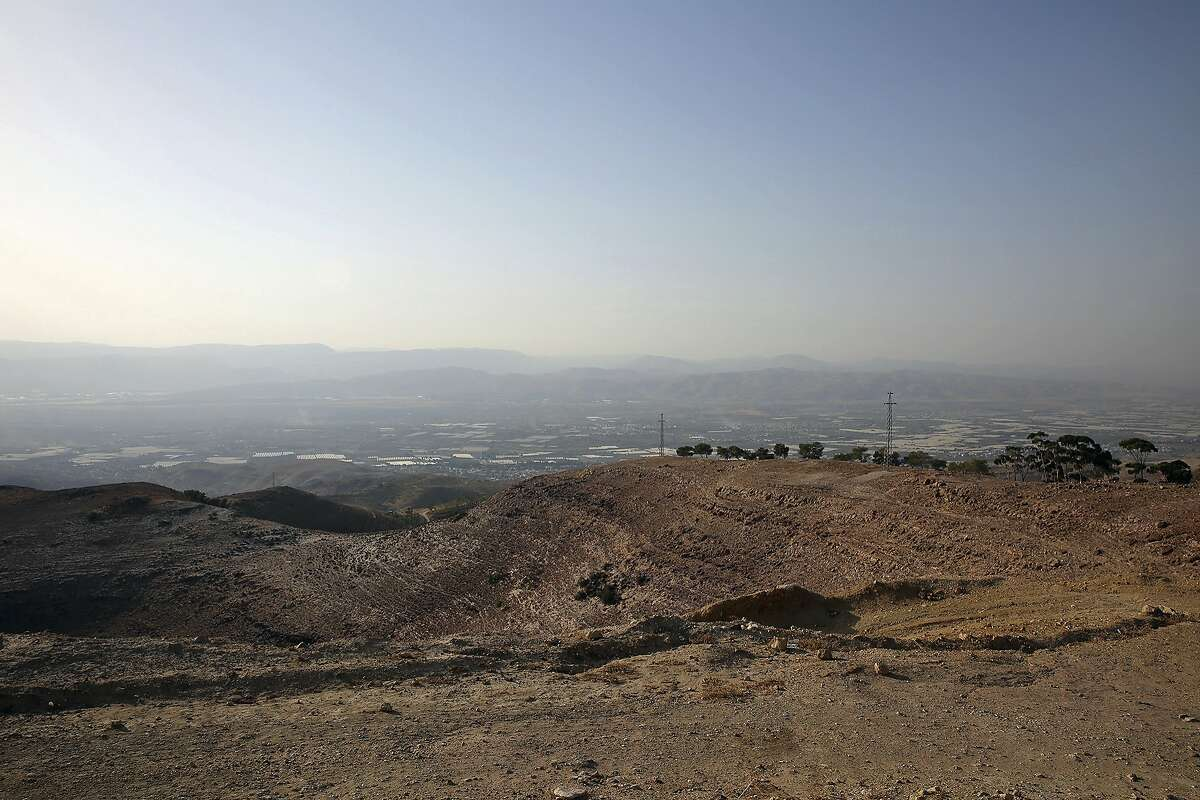 This Oct. 23, 2017 photo shows the Jordan River Valley, whose ecosystem has been badly hurt by water diversions to urban centers as seen from a hilltop in western Jordan. Recent studies say the kingdom, a Western ally and refugee host nation with a growing population, is being hit particularly hard by climate change, getting hotter and drier than previously anticipated. (AP Photo/Omar Akour)