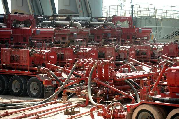 A series of Halliburton pumping units provide pressure to a wellhead on a fracking site managed by Octane Energy near Stanton.