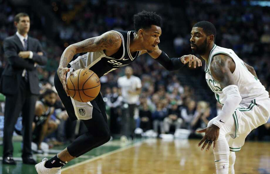 San Antonio Spurs' Dejounte Murray drives past Boston Celtics' Kyrie Irving during a game in Boston on Oct. 30. Photo: Michael Dwyer /Associated Press / AP2017