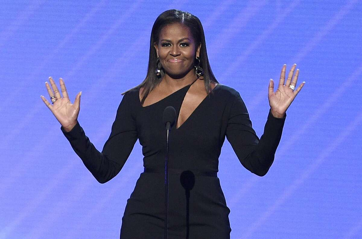 In this July 12, 2017, file photo, former first lady Michelle Obama presents the Arthur Ashe Courage Award at the ESPYS at the Microsoft Theater in Los Angeles. Obama was in San Francisco in November to speak at the Salesforce Dreamforce conference.