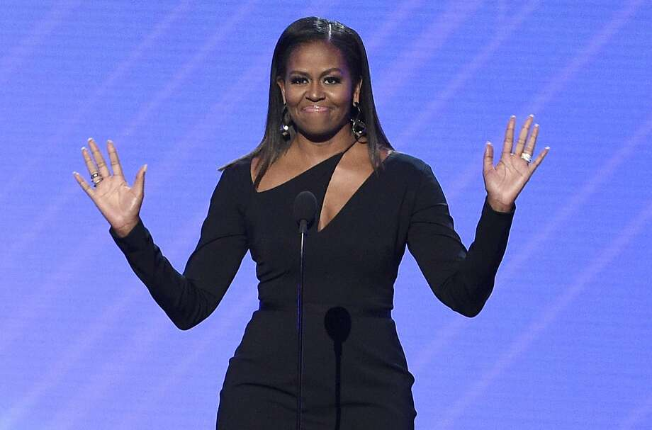 In this July 12, 2017, file photo, former first lady Michelle Obama presents the Arthur Ashe Courage Award at the ESPYS at the Microsoft Theater in Los Angeles. Obama was in San Francisco in November to speak at the Salesforce Dreamforce conference. Photo: Chris Pizzello, Associated Press