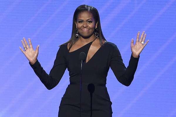 FILE - In this July 12, 2017, file photo, former first lady Michelle Obama presents the Arthur Ashe Courage Award at the ESPYS at the Microsoft Theater in Los Angeles. Obama said at a women's conference in Philadelphia on Oct. 3, 2017, that the lack of diversity among some segments of the political landscape is a reason that �people don�t trust politics.� (Photo by Chris Pizzello/Invision/AP, File)
