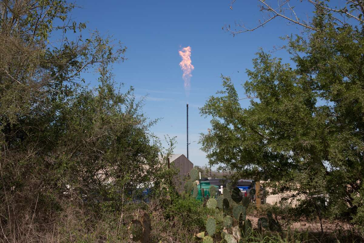 October 16, 2013, Nordheim Texas , A natural gas flare coming from a site used in the prodcution of the Eagle Ford Shale the most prodcution hydraulic fraturing area in the county. The hydraulic fraturing industry is controversial as the long and short term effects of horizontal drilling are unknown. (Photo by Julie Dermansky/Corbis via Getty Images)