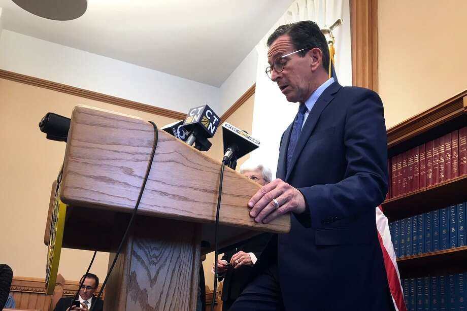 Connecticut's longest budget impasse ended quietly Tuesday afternoon when Gov. Dannel P. Malloy signed the bill into law. Photo: Ken Dixon / Hearst Connecticut Media / Connecticut Post