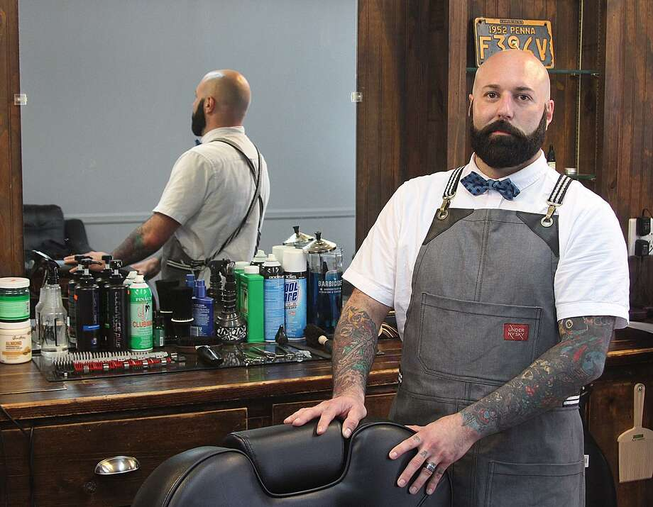 Jared Gelbert, owner of the barber shop Dapper Den, stands in his new place of business on Tuesday, July 12, 2016, in downtown Ridgefield, Conn. Gelbert held his grand opening event on Tuesday. Photo: Chris Bosak / Hearst Connecticut Media / The News-Times
