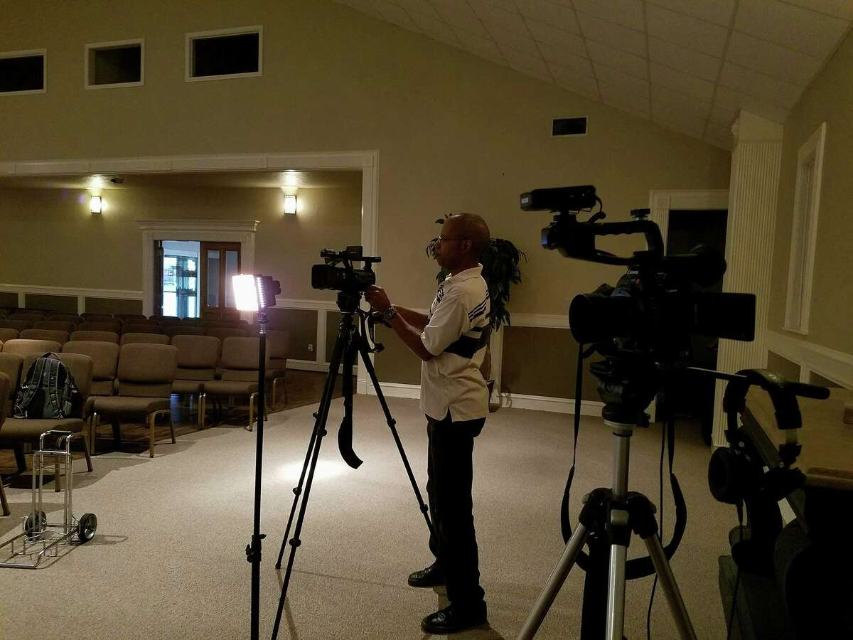 Elgin Alexander sets up for an interview on a documentary focusing on the volunteer efforts after Hurricane Harvey. Alexander, along with his wife, Lisa, shot over a month of footage of volunteers gutting and cleaning affected residents' homes.