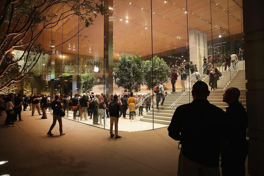CHICAGO, IL - OCTOBER 20:  Guests attend the grand opening of Apple's Chicago flagship store along Michigan Avenue on October 20, 2017 in Chicago, Illinois. The glass-sided store sits on shore of the Chicago River in the city's downtown.  (Photo by Scott Olson/Getty Images) Photo: Scott Olson, Getty Images